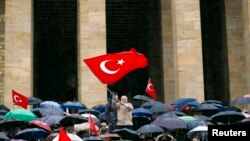 FILE - Wives and relatives of retired and active military officers charged in the so-called Sledgehammer trial hold a protest at Anitkabir, the mausoleum of Mustafa Kemal Ataturk, founder of secular Turkey, in Ankara, Feb. 19, 2011.