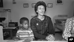 FILE - Joan Mondale, wife of Democratic presidential candidate Walter Mondale, right, sits with four-year-old Peter Blue during a campaign visit at the Childrens Village daycare center in Philadelphia, Pennslyvania, Sept. 6, 1984.
