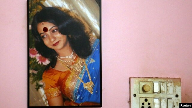A portrait of Savita Halappanavar is seen on the wall of her parents' home in Belgaum in the southern Indian state of Karnataka, November 16, 2012.