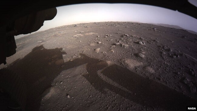 NASA released this photo as the first high-resolution, color image to be sent back by the Hazard Cameras (Hazcams) on the underside of the Perseverance rover after its landing on Mars. (NASA)