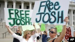 People show their support for Josh Holt, an American jailed in Venezuela, during a rally at the Utah State Capitol, July 30, 2016, in Salt Lake City. Laurie Holt says her son was mistakenly accused. Josh Holt was arrested on suspicion of weapons charges after he traveled to Venezuela on a tourist visa to marry a fellow Mormon he met on the internet.