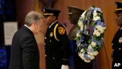 New United Nations Secretary-General Antonio Guterres, left, participates in a ceremony to honor U.N. employees killed in the line of duty at U.N. headquarters, Tuesday, Jan. 3, 2017. (AP Photo/Seth Wenig)