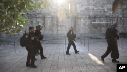 Israeli police officers walk outside the Al Aqsa Mosque compound in Jerusalem's Old City, July 25, 2017.