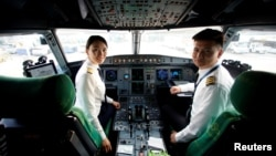 Captain Han Siyuan, 30, poses in the cockpit of Spring Airlines' Airbus A320 before taking off at Hongqiao International Airport in Shanghai, China, Oct. 18, 2018.