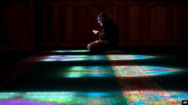 A Crimean Tatar man prays at a mosque in Bakhchysarai, Ukraine, March 10, 2014.