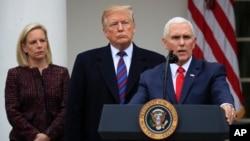 UMnu. Donald Trump lobona ngezomvikela ekuhlangothi lukahulumende olweHomeland Security uKirstjen Nielsen loMnu. Mike Pence, umsekeli kaTrump.