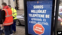 FILE - A poster in Budapest reads 'Soros would settle millions from Africa and the Middle East. Stop Soros!,' Feb. 1, 2018. The proposed constitutional change targets civic groups, some of which are supported by Hungarian-American financier George Soros.