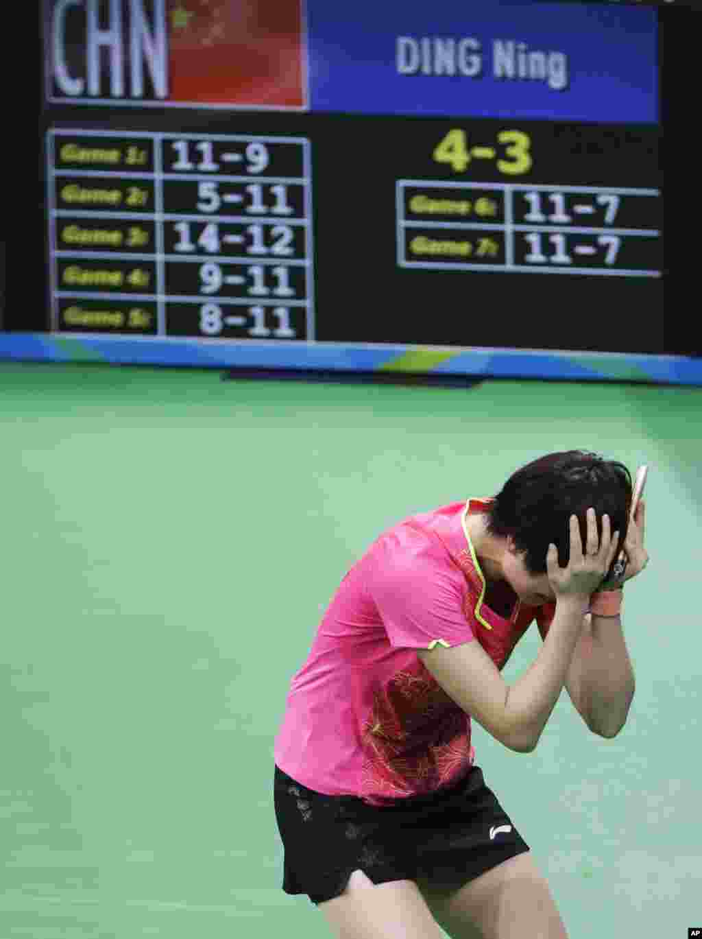 Ding Ning, of China, reacts after defeating Li Xiaoxia, of China, in the women's singles table tennis gold medal match at the 2016 Summer Olympics in Rio de Janeiro, Brazil, Wednesday, Aug. 10, 2016.