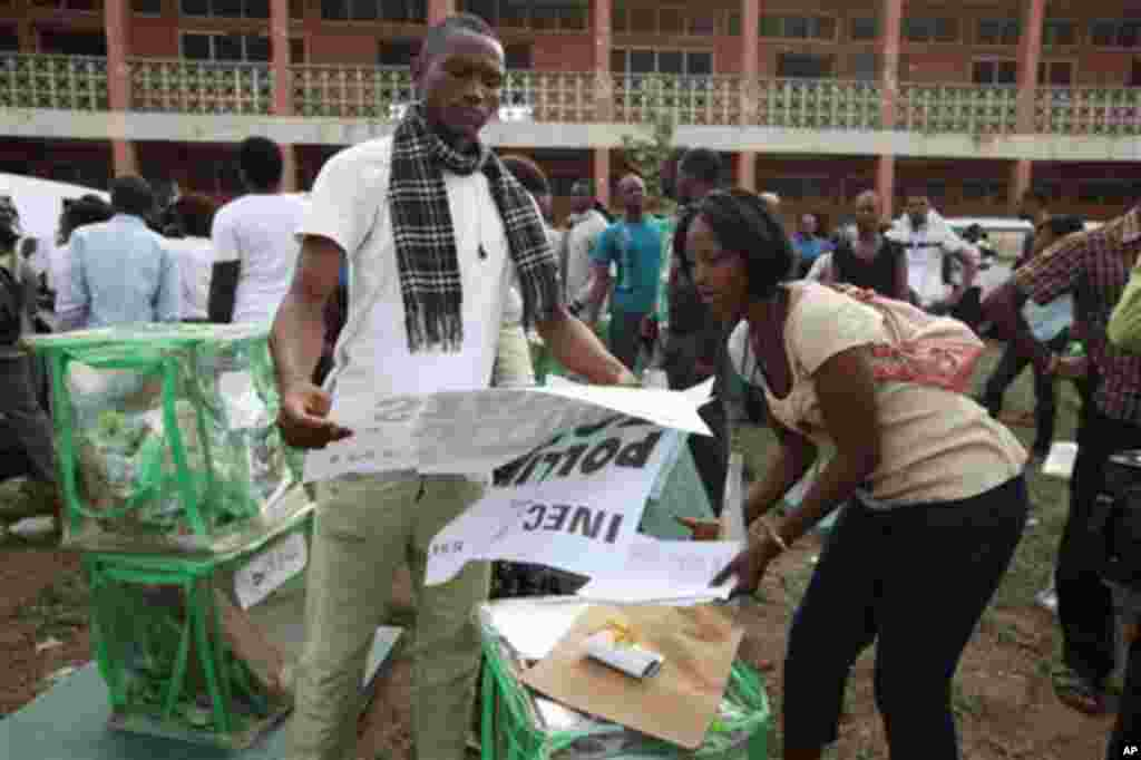 Electoral Officials check election materials at a distribution centre at Oyeleye in Ibadan, Nigeria, Saturday, April 9, 2011.