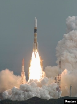 FILE - An H2-A rocket carrying Japan's fourth spy satellite blasts off from the southern island of Tanegashima, Feb. 24, 2007.