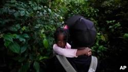 Migrants trek north, near Acandi, Colombia, Sept. 15, 2021.