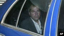 FILE - John Hinckley Jr. arrives at U.S. District Court in Washington, Nov. 18, 2003.
