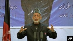 Afghan President Hamid Karzai speaks during a gathering in Kabul, Afghanistan, April 17, 2012.