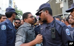Maldivian opposition supporters scuffle with security forces officers during a protest demanding the release of political prisoners in Male, Maldives, Feb. 2, 2018.