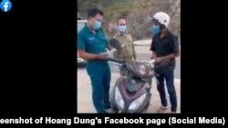 Một cán bộ phường ở Tp.Nha Trang phạt một công nhân vì ra đường mua bánh mì, nước uống, 18/7/2021.