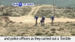 VOA60 World PM - Israeli Forces Work to Clear West Bank Settlement