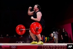 Laurel Hubbard of New Zealand reacts after a lift in the women's +87kg weightlifting event at the 2020 Summer Olympics, Aug. 2, 2021.