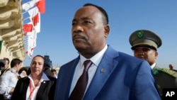 FILE - Niger President Issoufou Mahamadou arrives on the occasion of a summit on migration in Valletta, Malta, Nov. 12, 2015.