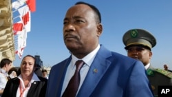 FILE - Niger President Issoufou Mahamadou arrives on the occasion of a summit on migration in Valletta, Malta, Nov. 12, 2015. Election results released Feb. 24, 2016, show he continues to hold a lead in his bid for a second term.