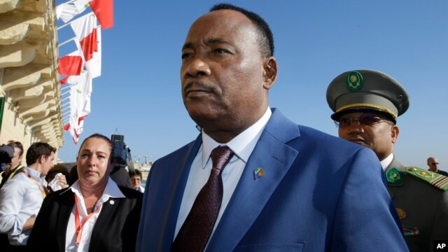 FILE - Niger President Mahamadou Issoufou arrives on the occasion of a summit on migration in Valletta, Malta, Nov. 12, 2015.