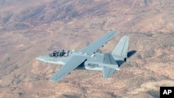 This Aug. 4, 2017, photo provided by the U.S. Air Force shows a Textron Scorpion experimental aircraft as it conducts handling and flying quality maneuvers above White Sands Missile Range near Alamagordo, N.M. The Scorpion is participating in test flights for the light-attack experiment known as the OA-X initiative being conducted Aug. 9, 2017, at Holloman Air Force Base in New Mexico.