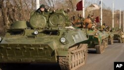 File - Pro-Russia rebels are seen driving in a convoy in Stakhanov, eastern Ukraine, April 2015.