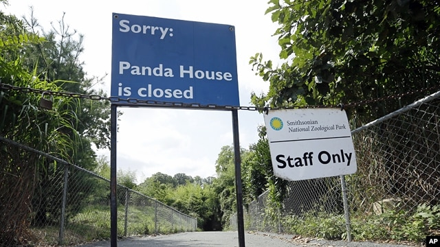 The closed signs posted at the Panda exhibit at the National Zoo in Washington the day after it was announced that the Zoo's female giant panda gave birth to a cub, Sept. 17, 2012.