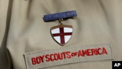 FILE - A detail from the Boy Scout uniform in front of the Boy Scouts of America headquarters in Irving, Texas, Feb. 4, 2013.