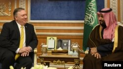 FILE - U.S. Secretary of State Mike Pompeo (L) meets with Saudi Crown Prince Mohammed bin Salman in Riyadh, Saudi Arabia, Jan. 14, 2019.