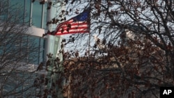 FILE - A U.S. flag flies at the U.S. Embassy in Ankara, Turkey, Feb. 2, 2013.