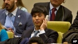 FILE - Shin Dong-Hyuk holds his earpiece as he listens during a meeting of the U.N. General Assembly human rights committee on a proposal to refer North Korea to the International Criminal Court for alleged crimes against humanity, Nov. 18, 2014.