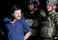 """FILE - Joaquin """"El Chapo"""" Guzman is escorted to a helicopter by Mexican soldiers and marines at a federal hangar in Mexico City, Jan. 8, 2016."""
