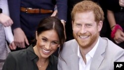 FILE - In this file photo dated Wednesday Oct. 3, 2018, Meghan, Duchess of Sussex and Britain's Prince Harry, make an official visit to the Joff Youth Centre in Peacehaven, Britain. Kensington Palace announced Monday Oct. 15, 2018, that Prince Harry and