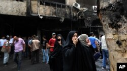 Iraqi women wait to hear about family members who went missing after a truck bomb hit Karrada, a busy shopping district in the center of Baghdad, Iraq, July 3, 2016.