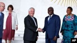 U.S. Secretary of State Rex Tillerson shakes hands with African Union (AU) Commission Chairman Moussa Faki, of Chad, after their meeting at African Union headquarters, Thursday, March 8, 2018 in Addis Ababa, Ethiopia.