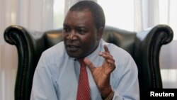 FILE - Kenya's Central Bank Governor Njuguna Ndung'u speaks to Reuters during an interview at his office in Nairobi.