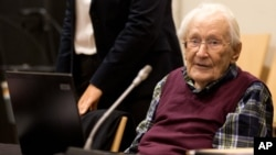 FILE - Former SS officer Oskar Groening waits in a courtroom in Lueneburg, northern Germany, July 8, 2015.