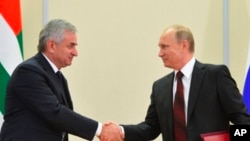 Russia Georgia Russian President Vladimir Putin, right, and leader of Abkhazia Raul Khadzhimba Sochi Russia Nov 24, 2014