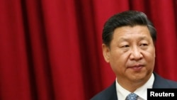 FILE - China's President Xi Jinping attends a meeting at Miraflores Palace in Caracas, Venezuela, July 20, 2014.