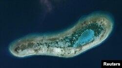 路透社2016年12月6日收到的由行星实验室在2016年7月19日拍摄的南中国海斯普拉特利群岛中由越南控制的日积礁。
