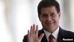 FILE - Paraguay's President Horacio Cartes gestures while in Brasilia, July 17, 2015.