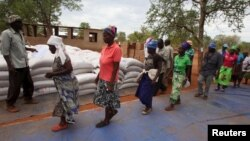 FILE: Villagers collect their monthly food ration provided by the United Nations World Food Program (WFP) in Masvingo, Zimbabwe.