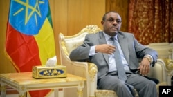 "FILE - Ethiopia's Prime Minister Hailemariam Desalegn is seen in his office in the capital Addis Ababa, Ethiopia, March 17, 2016. Announcing the reshuffle, Desalegn said the new ministers were picked for competence and commitment rather than ""party loyalty."""