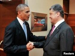 Обама со новоизбраниот украински претседател Петро Порошенко
