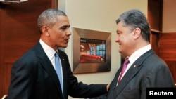 Predsednik Barak Obama i novoizabrani ukrajinski predsednik Petro Porošenko prilikom susreta u Varšavi, 4. jun 2014.
