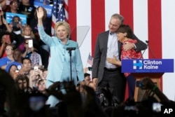 FILE - Sen. Tim Kaine, D-Va., hugs his wife Anne Holton during a with Democratic presidential candidate Hillary Clinton at Florida International University Panther Arena in Miami, Saturday, July 23, 2016.