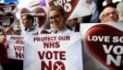 'No' supporters hold banners after a campaign rally in Glasgow, Scotland, Sept. 17, 2014.