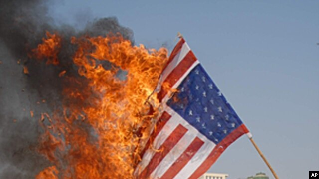Pakistani protesters burn representation of U.S. flag at a rally to condemn drone attacks on militants allegedly hiding in Pakistan tribal areas, in Multan, Pakistan, (File January 11, 2012).