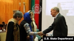 U.S. Ambassador to Afghanistan, Michael McKinley congratulates women civil society leaders.
