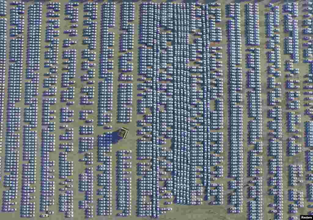 An aerial view shows new Audi cars in an open-air parking lot in Changchun, Jilin province, China.